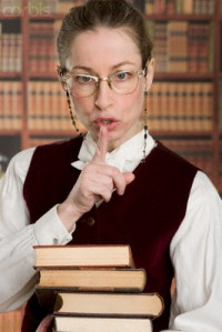 Librarian Shushing --- Image by © Tom Grill/Corbis